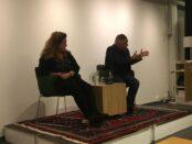 """Advokatparet Lena Ebervall och Per E Samuelsson är författarna bakom nyutgivna boken """"Stormfågel"""". 12 stycken sitter i publiken när Skurups bibliotek återgår till sin vanliga repertoar. Foto: Julia Wiberg"""